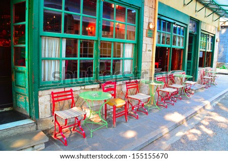 traditional cafe in Ioannina Greece chairs outside colors summer - stock photo