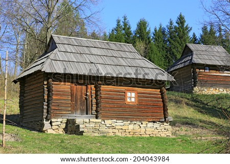 Traditional carpathian wooden house in open-air museum Pirogovo. Kiev, Ukraine  - stock photo