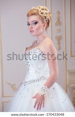 Traditional caucasian bride, studio shot - stock photo