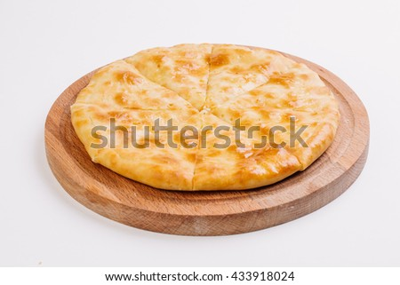 Traditional Caucasian cuisine - hot Ossetian pie in the bowl