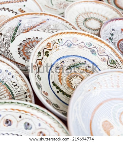 Traditional ceramic plates exposed to a fair - stock photo