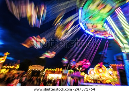 Traditional chain carousel at night - stock photo