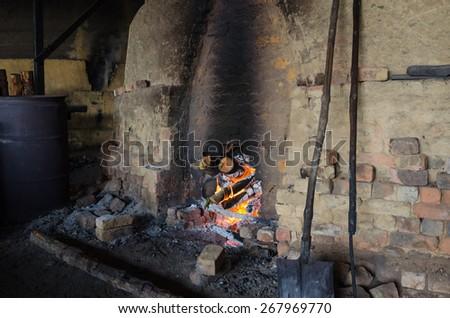 Traditional Charcoal factory, Sepetang, Malaysia - Traditional Charcoal factory in Kuala Sepetang Malaysia - stock photo