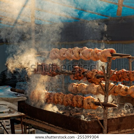 Traditional chicken barbecue on charcoal grill with beautiful smell - stock photo