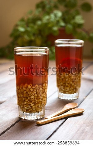 Traditional Chilean non-alcoholic cold drink called Mote (cooked husked wheat) con Huesillo (dried peach) (Selective Focus, Focus on the first drink)   - stock photo