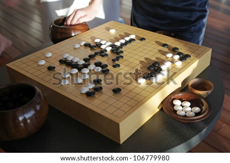 Traditional chinese boardgame Go - stock photo