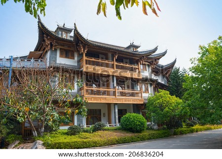 Traditional chinese building, located in Yunnan Nationalities Village, Kunming City, Yunnan Province, China. - stock photo