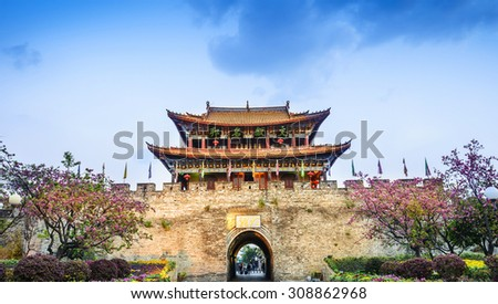Traditional Chinese building. South Gate of Dali Old Town. Text on the pavilion translating into English is famous town of culture. Located in Dali City, Yunnan province, China - stock photo
