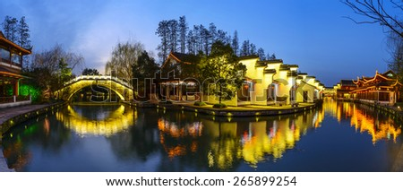 Traditional Chinese buildings at night. Located in Water street of Nanjing City, Jiangsu Province, China. - stock photo