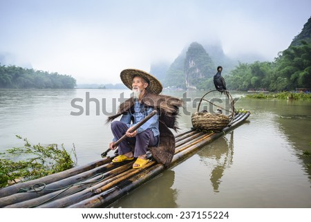 Traditional Chinese cormorant fisherman on the Li River in Yangshuo, China. - stock photo