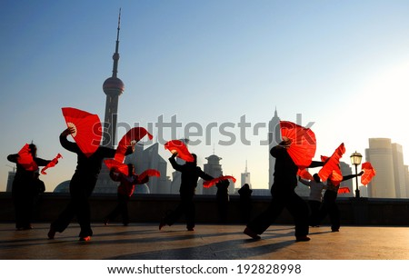 Traditional Chinese dance with fans. - stock photo