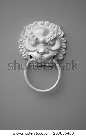 Traditional Chinese Door Knocker (in monochrome) - stock photo
