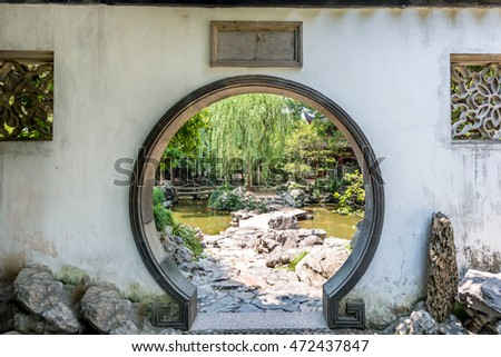 Traditional Chinese garden white round entrance. Yuyuan Chinese garden in Shanghai, China.