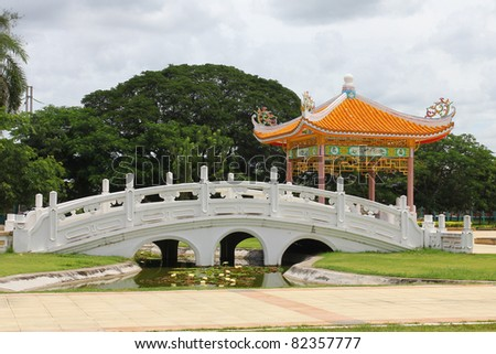 Traditional chinese garden with pond. - stock photo