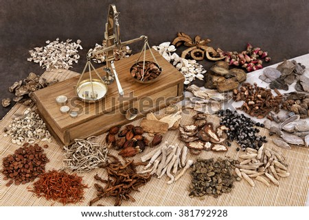 Traditional chinese herbal medicine selection with herb ingredients and old scales.  - stock photo