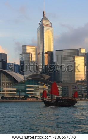 Traditional Chinese Junkboat sailing in Victoria Harbor, Hong Kong. - stock photo