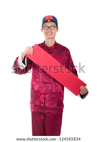 traditional chinese man with greeting banner during chinese new year - stock photo