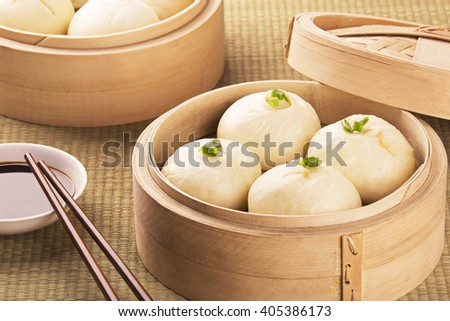 Traditional Chinese meal of baozi also known as dim sun with soy sauce
