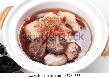 Traditional Chinese Meat Soup In Herb Stock In Claypot
