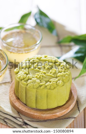 Traditional Chinese mid autumn festival food. Snowy skin mooncakes.  The Chinese words on the mooncakes means green tea with red bean paste, not a logo or trademark. - stock photo