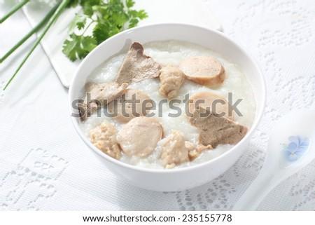 Traditional chinese porridge rice gruel in bowl, congee.  - stock photo