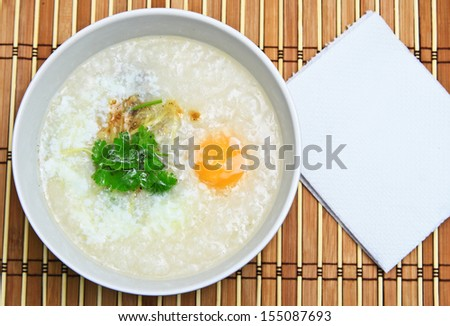 Traditional chinese rice gruel in white bowl./Con-gee.
