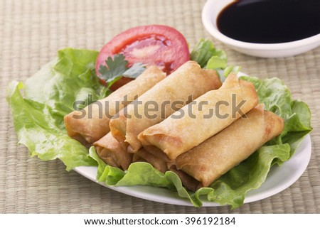 Traditional Chinese Spring Rolls with a dipping sause of soy sause - stock photo