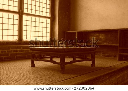 Traditional Chinese style furniture - kang table, in Chinese rural areas - stock photo