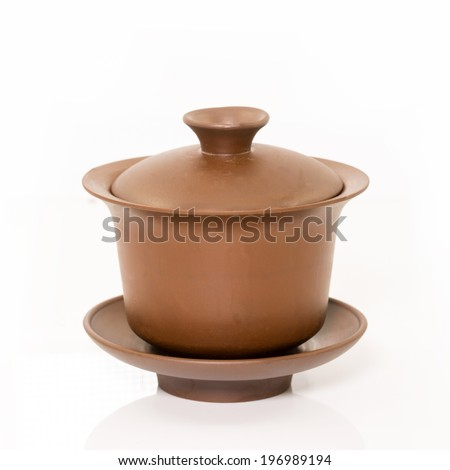 traditional Chinese tea cups on the plain background