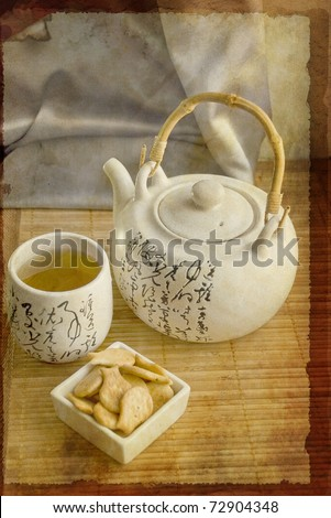 Traditional chinese tea on Bamboo mat. Photo in retro style. - stock photo