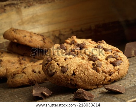 Traditional chocolate chip cookies in the foreground - stock photo