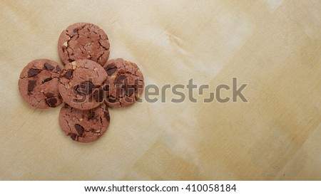 Traditional chocolate chip cookies with peanut on plain wooden table. Space for text. View top.