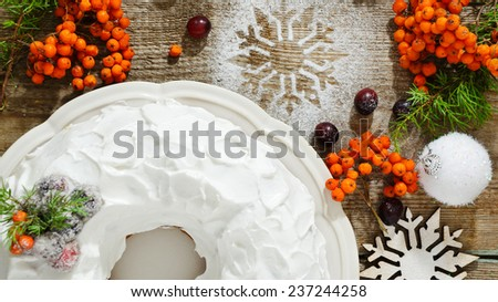 Traditional Christmas and New Year cake with cranberries and frosting - stock photo