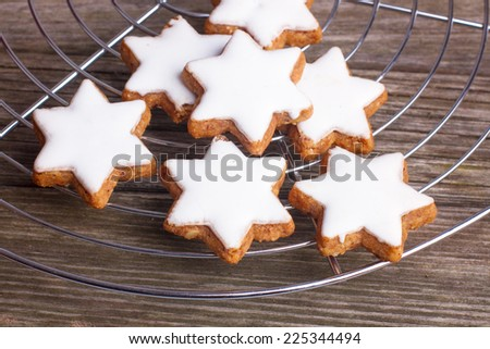 Traditional christmas cinnamon cookies in star form - stock photo