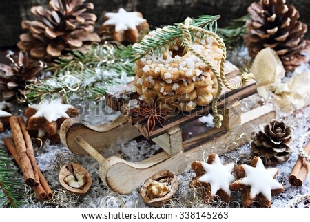 Traditional Christmas cookies and spices on a rustic wooden table.Selective focus
