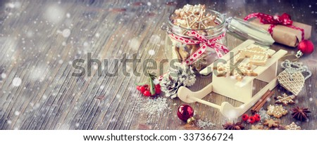 Traditional christmas cookies with icing, festive vintage table decoration, lots of copy space - stock photo