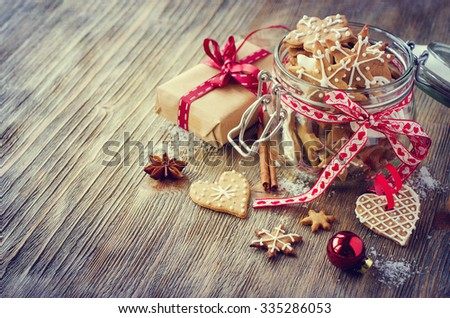 Traditional christmas cookies with icing, festive vintage table decoration with gift box copy space