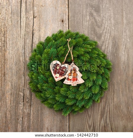traditional christmas decoration evergreen wreath on wooden background - stock photo