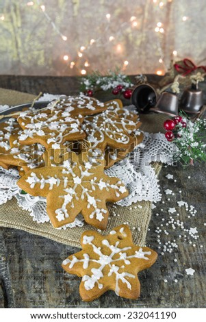 Traditional Christmas gingerbread cookies on rustic wooden background - stock photo