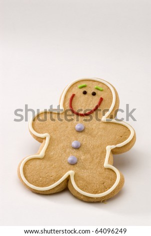 Traditional Christmas gingerbread man cookie on white background