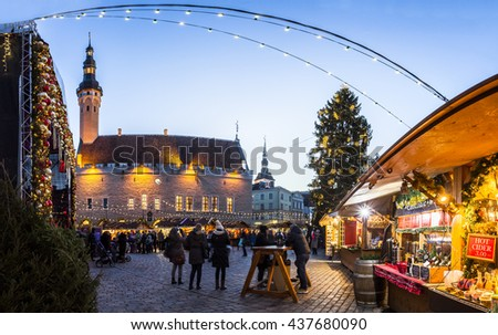 Traditional Christmas market in Tallinn old town. HDR image. Long time exposure with motion blur. - stock photo