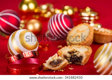 Traditional Christmas mince pies and xmas festive decorations - stock photo