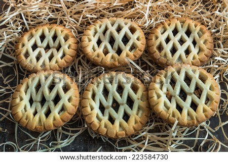 Traditional Christmas mince pies on old rustic wooden table  - stock photo