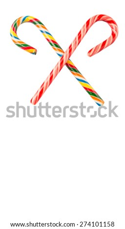 Traditional Christmas red and white and multicolored candy cane over white background