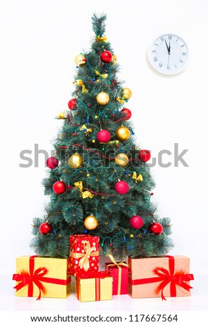 Traditional Christmas tree with baubles and gifts on white - stock photo