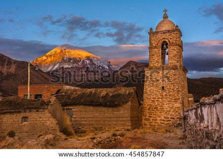 Traditional church and Sajama volcano, highest peak (6 542 m) in Bolivia