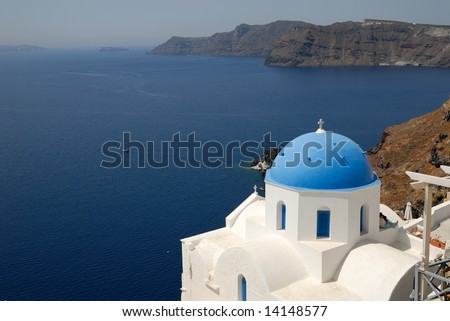 Traditional church with blue cupola in Oia, Santorini, Greece