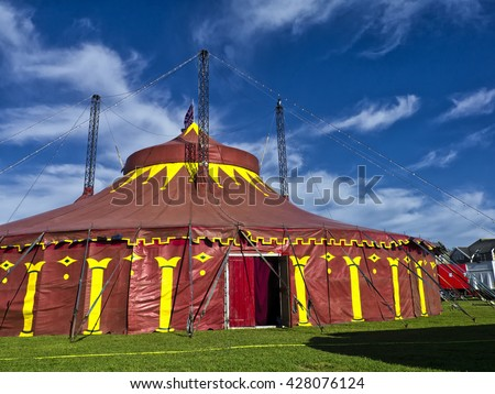 Traditional Circus Big Top; Circus tent against windswept summer sky  - stock photo