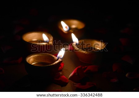 Traditional clay diya lamps lit during Diwali celebration