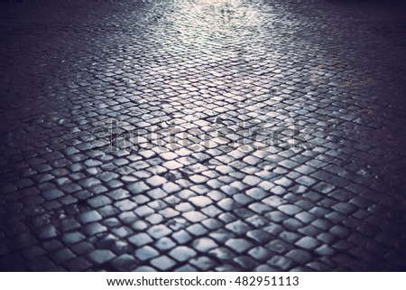Traditional cobbled street in Rome, Italy
